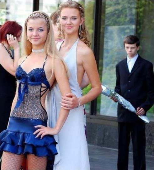 two pretty girls watched enviously by an urgly guy